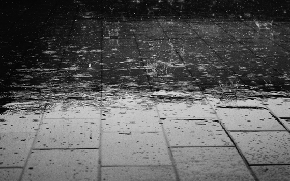 Rain falling on pavement